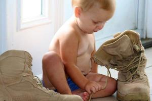 Ana Dorr exploring her fathers combat boots. Photo credit: Jackie Dorr