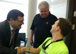 U.S. Rep. Gus Bilirakis (FL-R), on the left, made a special trip to meet Army Ranger Cory Remsburg (right) and his father, Craig Remsburg (center) when they visited the medical staff at Haley.