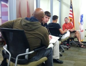 Student veterans pair off to complete an exercise during a 5-day USF Veterans Employment Project August session.