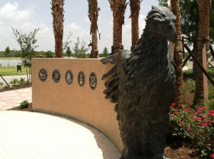 One of the eagle sculptures that guards a side entrance into Patriot Plaza. Just beyond are the seals for all branches of the Armed Forces.