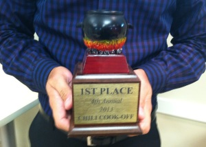 Royce Thomas shows off his trophy for last year's winning chili recipe.