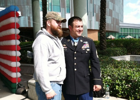 MSgt. Leroy Petry (right) took time to greet everyone who stood in line to meet him and take a photograph.