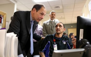 Bob McDonald's first visit as VA Secretary was to the Phoenix VAMC where he met with veterans and employees like Medical Support Assistant Michael Logie. He also visited the Las Vegas VAMC during the trip. Photo courtesy of the VA blog Vantage Point