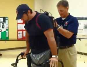 (April 2014) Lead therapist Michael Firestone adjusts the Exoskeleton computer backpack for veteran Josh Baker, paralyzed after a motorcycle accident. Credit Bobbie O'Brien / WUSF Public Media