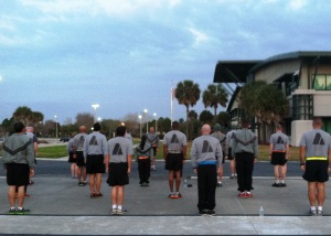 Active Guard Reserves from the 53rd Infantry Brigade Combat Team do PT, physical training, in the parking lot of their Pinellas Park, FL headquarters.