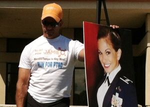 Gulf War veteran and former Ranger Alex Estrella holds onto the photo of Jamie at the kick-off ceremony outside MacDill Air Force Base's main gate for his 405-mile run to Key West.
