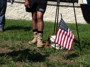 Alex Estrella wore combat boots for the first few miles of his run but blisters forced him to switch to running shoes.