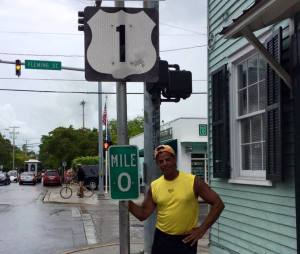 Alex Estrella reached to 0 mile marker of US 1 in Key West on Tuesday at 1:30 p.m. after running and walking 405 miles from Tampa. Photo by Monica Kim.