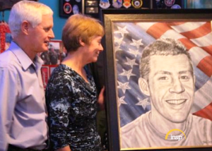 Retired Major Gen. Robert Steel and his wife, Dee, with the Brush of Honor portrait of their son, Capt. James Steel.