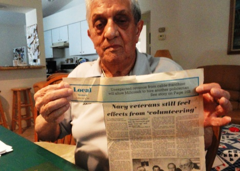 Navy veteran John Tedesco holds up a newspaper article from 1991 when he and several buddies from the Great Lakes Naval Training Station filed claims for VA benefits related to their mustard gas exposure.