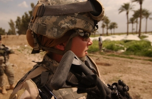 U.S. Army Sgt. Ashley Hort keeps her weapon at the ready as she provides security for her fellow soldiers during a raid in Al Haswah, Iraq, on March 21, 2007.  Hort is a team sergeant with the 127th Military Police Company deployed from Hanau, Germany.  DoD photo by Spc. Olanrewaju Akinwunmi, U.S. Army.