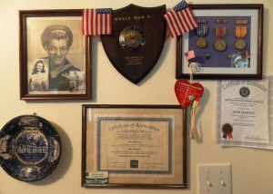 John Tedesco's wall of memorabilia from his WWII service in the Pacific.