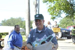 "Dr. William Lennox - the new president - helps carry a student's belongings to the dorm on ""Move-In Day"" Thursday at Saint Leo University. Renee Gerstein Saint Leo University"