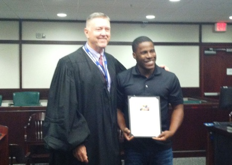 Hillsborough Circuit Judge Greg Holder with a graduate from Veterans Treatment Court in August.