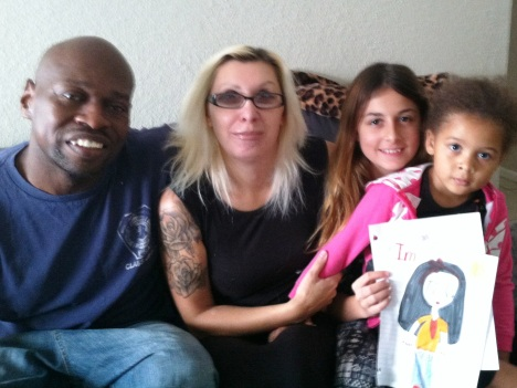 Transitioning Army veteran Keith Norman, his wife Lina Norman and two of their four daughters, Shelia Encheva, 12, and Kiara Norman, 3. Bobbie O'Brien WUSF Public Media