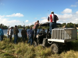 Veterans and volunteers look on as one of the gators is captured and killed on Lake Hancock.
