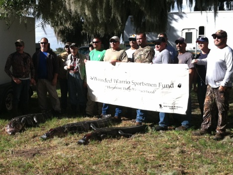 Veterans from all generations pose for a photo after the successful hunt in December 2015.