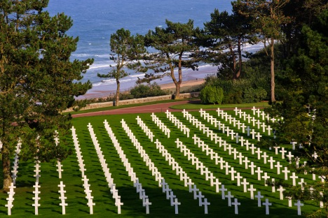Omaha Beach in the background where Pvt. Leo Chalcraft is buried at the Normandy American Cemetery and Memorial, on September 27, 2013, at Colleville-sur-Mer, France. (Photo by Warrick Page - American Battle Monuments Commission)