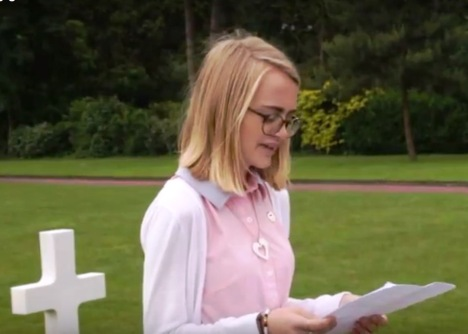 Largo High School student Konner Ross reads her eulogy for Private Leo Chalcraft at his graveside at the Normandy American Cemetery in late June.