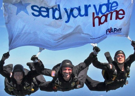 The Golden Knights fly a Federal Voting Assistance Program banner promoting absentee voting. Credit: FVAP